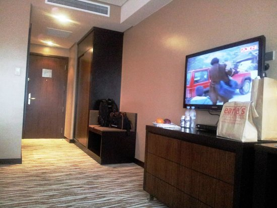 Acacia Hotel Manila Closet Tv And Hidden Mini Bar
