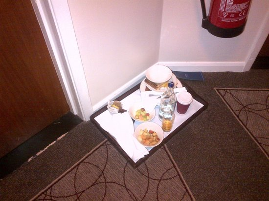 Hilton Milton Keynes: This is the door to our 'suite' on the left, yet these were NOT our dishes sat outside out room