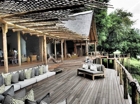 Lion Sands - Tinga Lodge: One of the decks overlooking Sabi river where you can have dinner / lunch / breakfast.