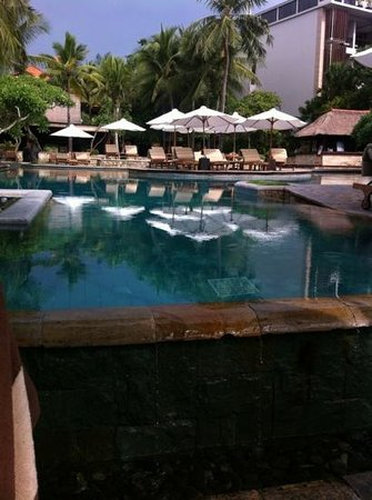 The Royal Beach Seminyak Bali - MGallery Collection: pool deserted as an afternoon storm comes in