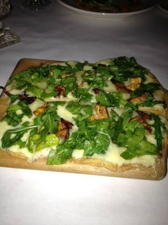 The Downtown Grocery: Grilled Flatbread with Chantrelle Mushrooms, Arugula Tossed with Sherry Vinaigrette and Cheese.