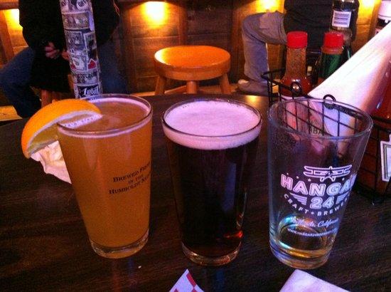 Murray's Saloon & Eatery: Hangar 24 light and dark orange beer. A local delight!