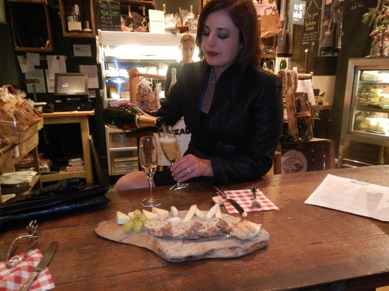 Champagne+Fromage - Covent Garden: My sweetheart pouring some bubbles