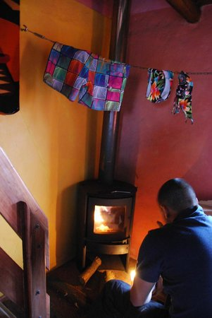 The Secret Garden Cotopaxi: The fire place in our cabana