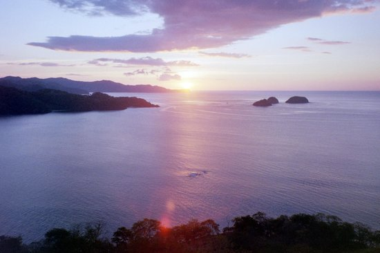 Sunset over Golfo Ppapagayo seen from Playa Hermosa heights