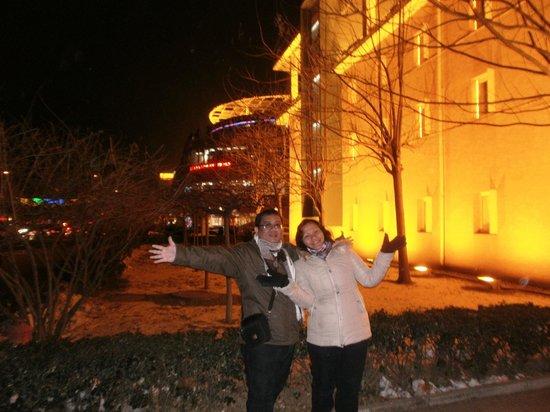 Ibis Tianjin TEDA: me n wife in front of Ibis Hotel
