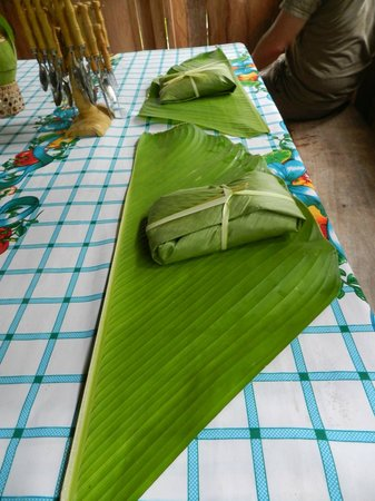 Soposo Rainforest Adventures: table set for lunch with our food wrapped in banana leaf packets