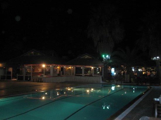 Start Apartments: The Pool & Bar at Night