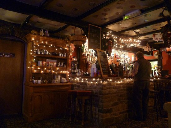 Moorcock Inn: The bar, covered in festive lights