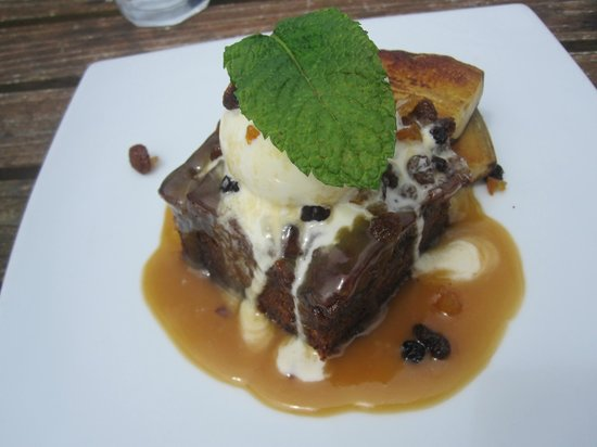 Elevation Cafe: Rich Date pudding with vanilla ice cream, grilled banana drizzle with caramel sauce