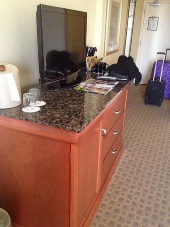 Rosen Centre Hotel : flat screen tv, safe and mini fridge located under the tv