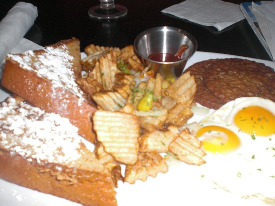 Aromas Coffeehouse & Restaurant: super combo with french toast, sausage, eggs, potatoes, toast & pineapple juice