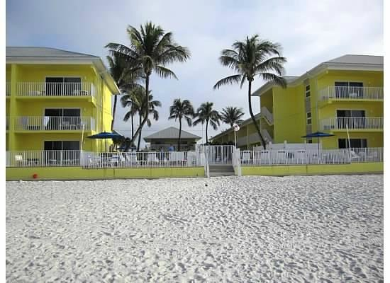 Sandpiper Gulf Resort: View from the water, the pool is right inside the gate - swim and view the gulf at the same time