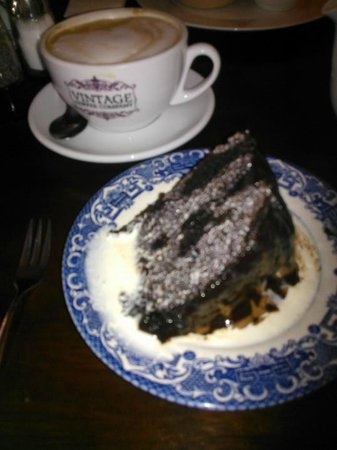 Lawrie's Bistro and Coffee House: Chocolate cake, with pouring cream, washed down with Cappuccino at VCC