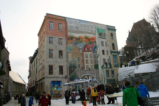 Fresco on the wall in lower Old Quebec depicting the history of Quebec