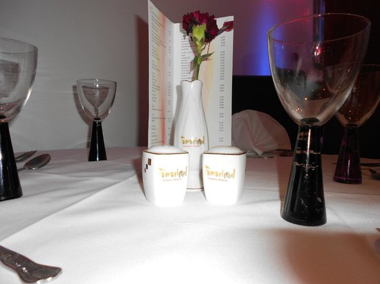 Table setting with Stylish Glassware and branded Condiments ...
