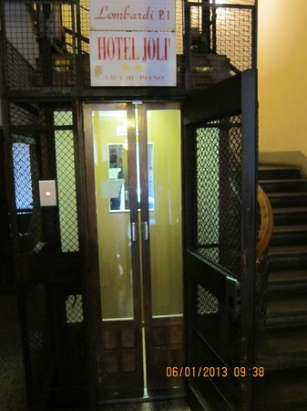 Lombardi Hotel: old style lift, needing to open 2 sets of doors to get in