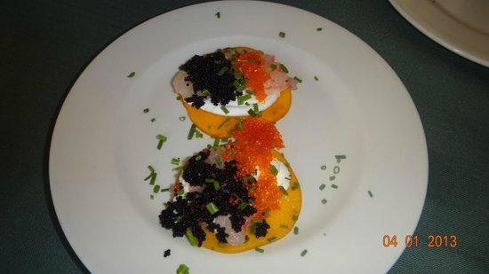 uri buri: Amazing bklack and red Caviar on Mascarpone on slice of exotiuc fruit