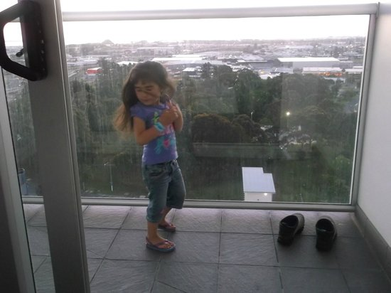Proximity Apartments Manukau: My daughter out on the balcony dancing lol.