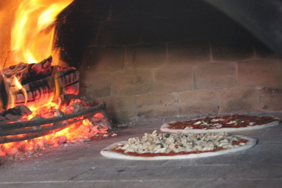 Spago': wood fired clay oven