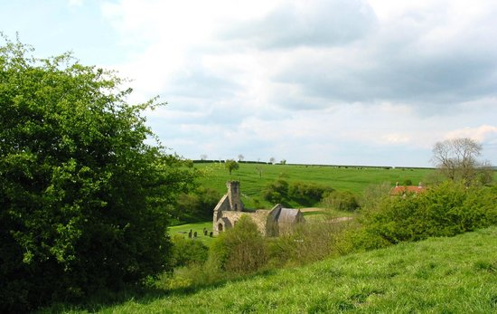Yorkshire, UK : Wharram Percy Churchlooking from higher up on the Wolds Way.