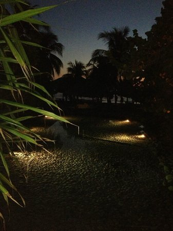 Villa del Sol Resort: The lagoons lit up at night
