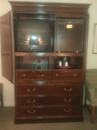 L'Enfant Plaza Hotel: Entertainment Center with small refrigirator next to it.