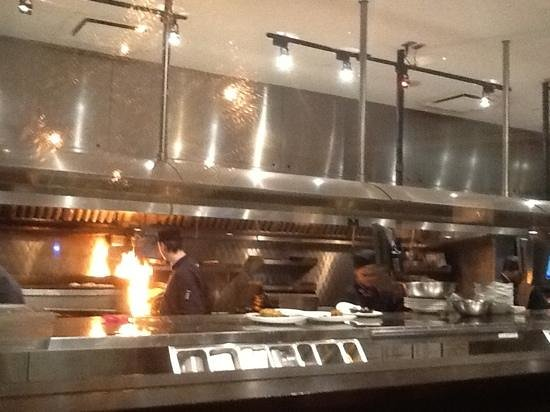 Moxie's Grill & Bar : A quick shot from my table at the kitchen staff hard at work behind the glass