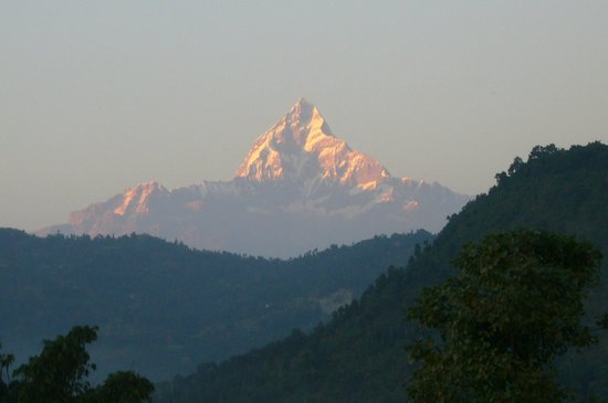 Rustika Guest House: The evening glow of the Sacred Machapuchare from the room window in early November