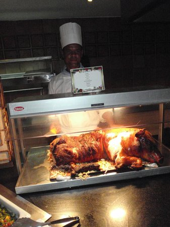 Grand Bahia Principe El Portillo : New Year gala night, suckling pig cut to order