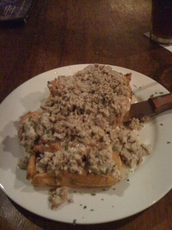 Southside 815: Sausage gravy over fried chicken on sweet potato waffles