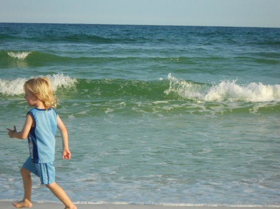 Harbor Watersports: Our toddler running in and around the Destin surf.