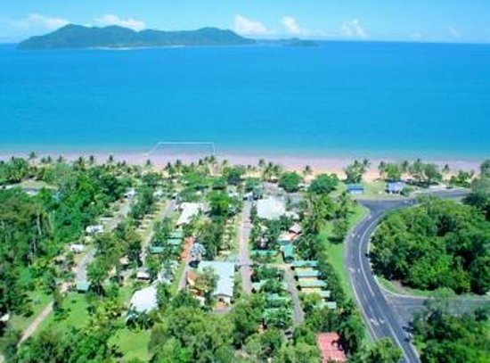 Beachcomber Coconut Holiday Park: Beach front with a view of Dunk Island, with the Cassowary Conservation Area at the rear.