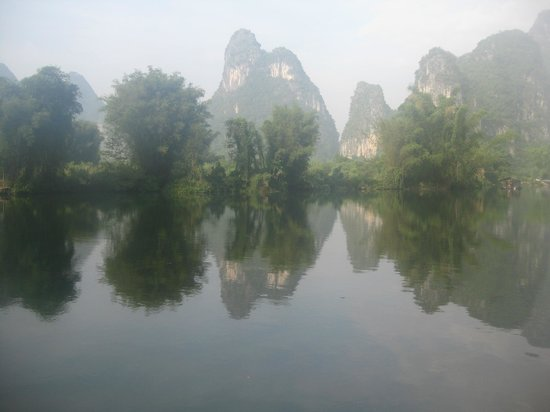 Yangshuo Mountain Retreat: Misty sunrise over iver to the karsts