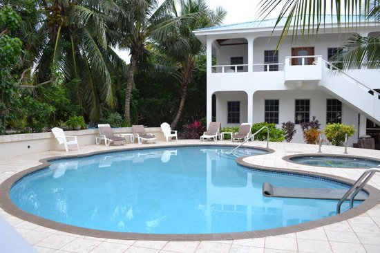 Cocotal Inn & Cabanas: The pool and the main house with two bedroom on second floor and one bedroom on main level.