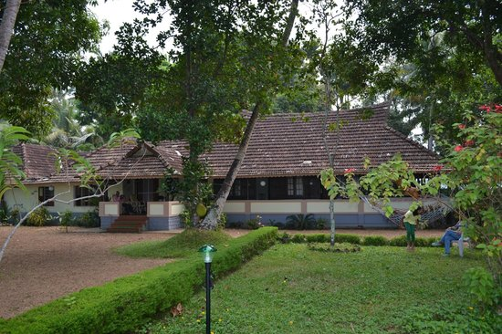 The Pamba Heritage Villa: house and garden from the river