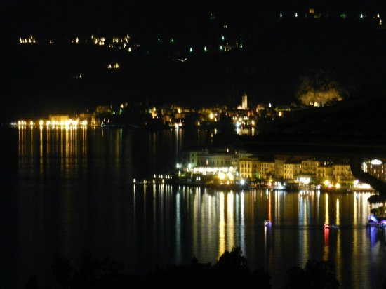 ‪بورجو لو تيراتزي: Bellagio and Varenna at night from the balcony‬