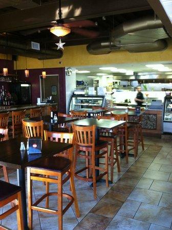 Sfizi Cafe: Open kitchen through the bar area