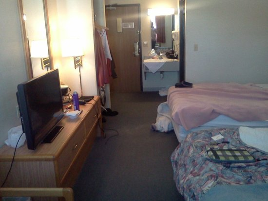 Eastwood Inn: open closet area left of door, tv, coffee pot on dresser,