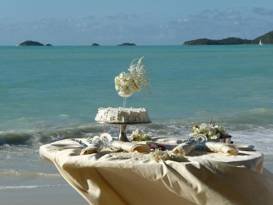 Cocobay Resort: Wedding table on beach at resort.