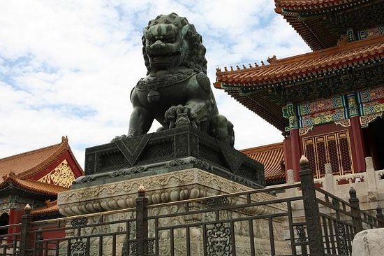 Beijing Impression Tours : bronze lion at the Gate of Harmony in Forbidden City