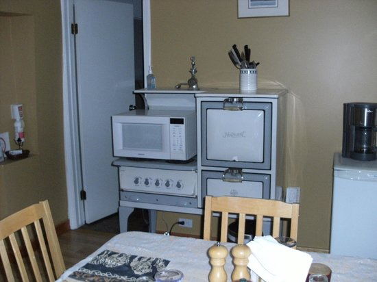 Cozy Cabin Bed and Breakfast: Kitchen area - the stove and oven around the microwave are decorative only