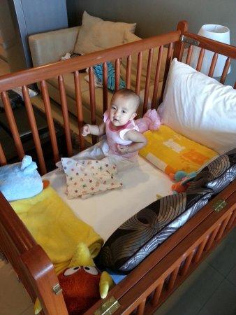 Viva Garden Serviced Residence: my lil girl loving her baby cot