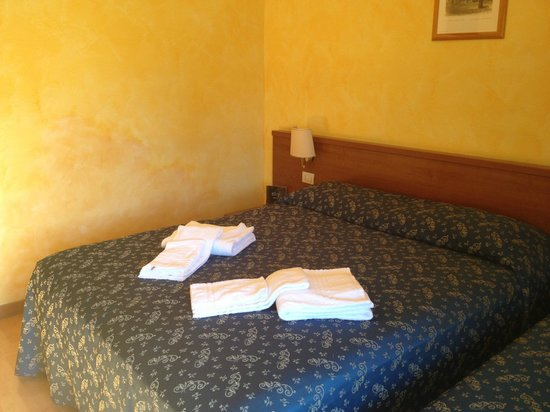 A View of Rome: Beds in the room