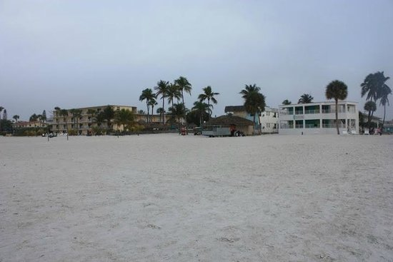 Carousel Inn on the Beach: View from the middle of the beach on the hotel (hotel on the right, tiki bar in the middle).