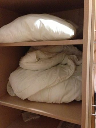 """Cumulus Kouvola: extra bed blankets and pillow """"nicely"""" folded :)"""