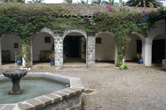 Hacienda Pinsaqui: A courtyard and rooms