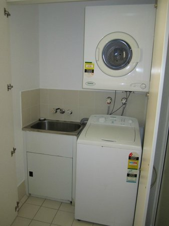 Tropical Nites: Laundry machines in bathroom cupboard