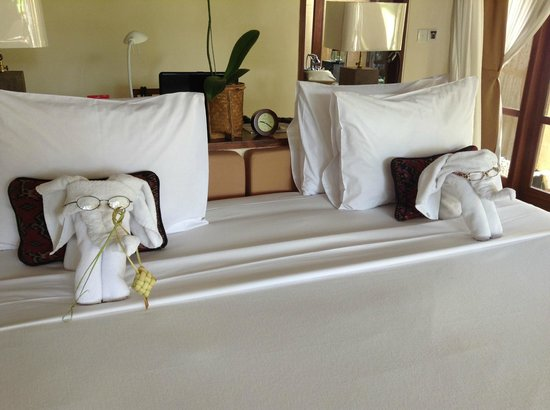 "Komaneka at Tanggayuda: The houseboys had a bit of fun one day leaving these familiar ""elephants"" on our bed"