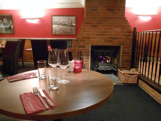 The Steakhouse Tapas & Grill: One of our most popular tables by the log fire